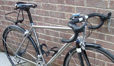 Titanium road bike with Brooks saddle, mudguards and bagman rack.