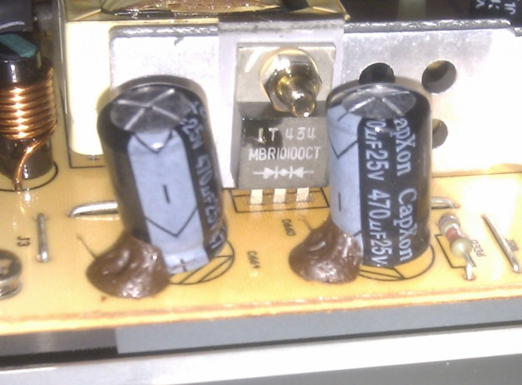 Blown capacitors with bulging tops.