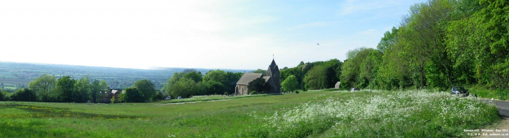 View showing small church and farmland