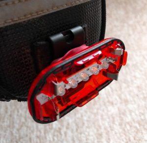 Broken rear light attached to bag