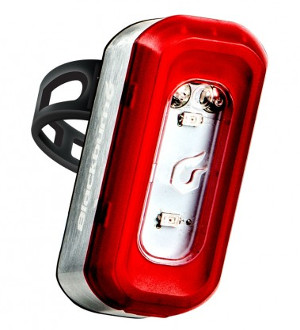 Rear light with silver body, red bezel and clear front with rubber strap behind