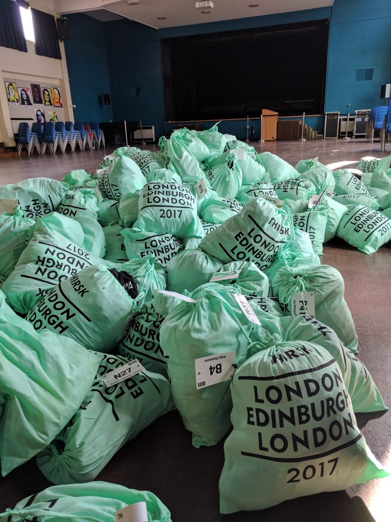 Light green bags with LONDON EDINBURGH LONDON 2017 written on them