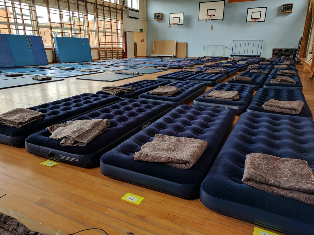 School gym with mattresses laid out