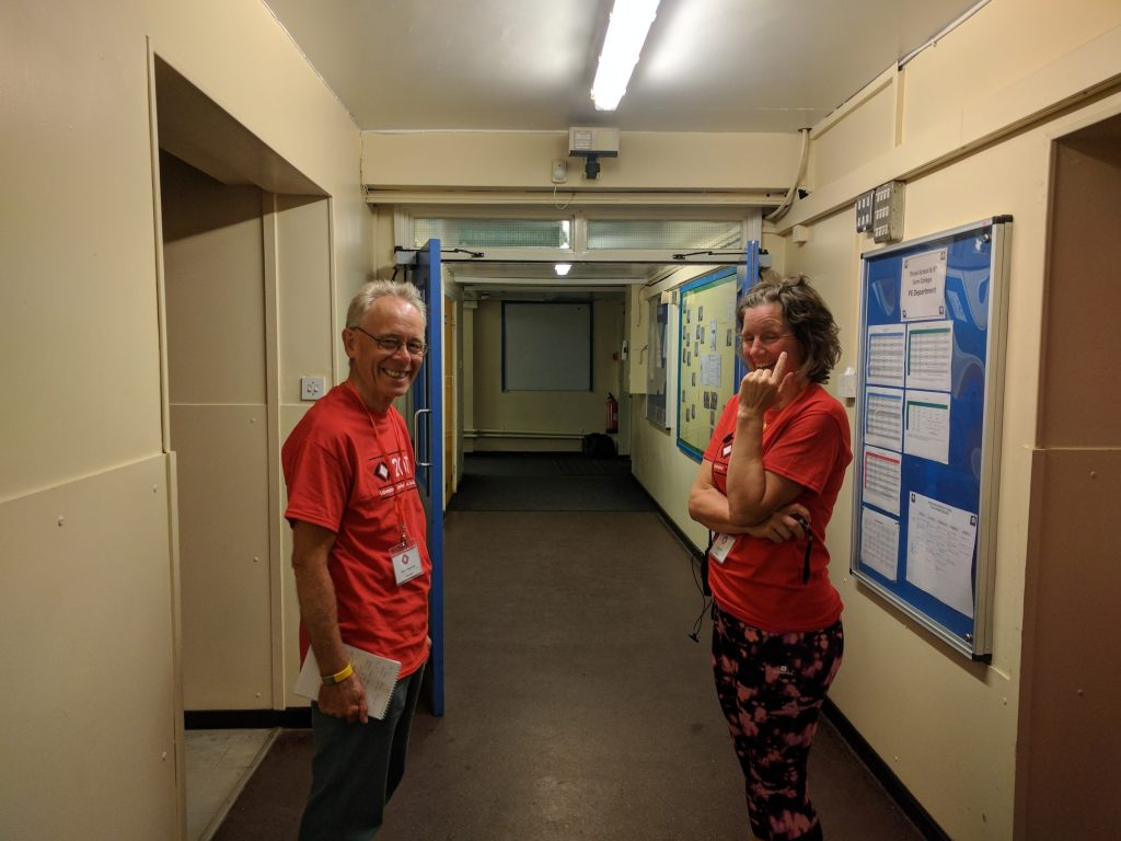 Volunteers in school corridor