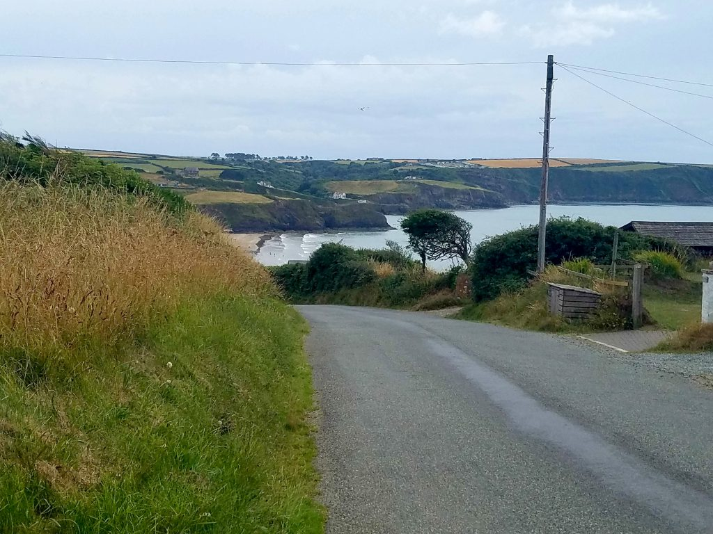 View from roadside of bay and coastline below